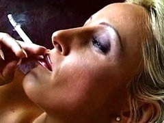 Blonde milf smokes a cigarette