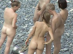 Sexy nudists are posing naked outdoors