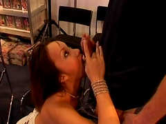 Rough anal sex in a video store with..