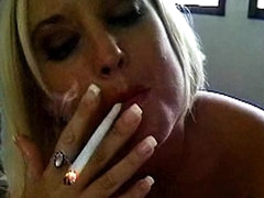 She smokes her cigarette and gives a BJ