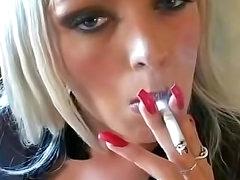 Sensual smoker rips her pantyhose open