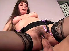 Hairy mature in sexy stockings banged
