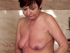 Horny mature sucks a stud's cock in..