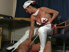 Latex nurse mistress pisses on him