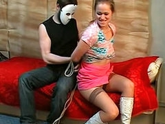 Masked man ties up a pretty girl