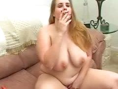 Fat girl smokes a cigarette