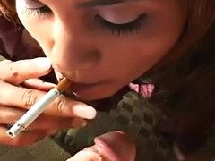 Beautiful brunette lady smokes a..
