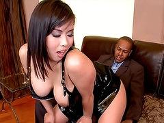 Asian in black latex boned in the..