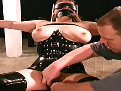 Latex bondage and outfits in dungeon