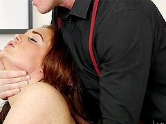 Curvy redhead Emma Leigh rides a cock..