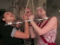 Asian and blondie are tied up on their..
