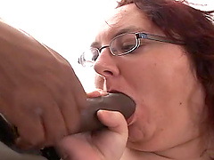 A redhead BBW sucks a BBC and gets her..