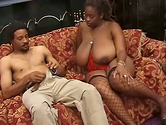 A huge breasted Black woman has a wild..