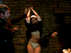 Sexy brunette nun gets tied up and..
