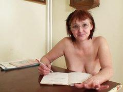 Redhead teacher masturbates her vagina