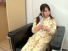 A cute Asian teen and her mother share..