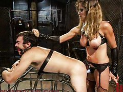 Sexy mistress in latex tortures a poor..