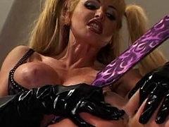Latex lesbian strapon sex scene