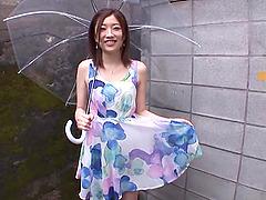 Smiling Japanese brunette Miki..
