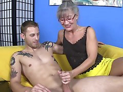 Granny goes wild on hunk's large prick