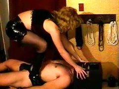 Femdom mistress in sexy latex abuses him
