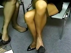 Nylon fetish women tease in office