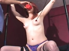 Redhead bound and taking a toy in cunt