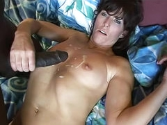 Slim brunette with black dick inside her
