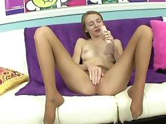 Teen is posing in her cute nice nylons
