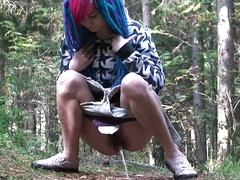 Blue haired cutie pissing outdoors