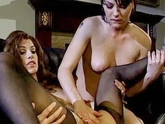 Erotic lesbian threesome with stockings