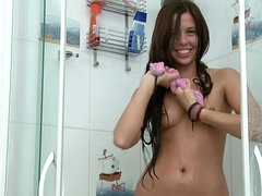 Happy smile on solo shower teen