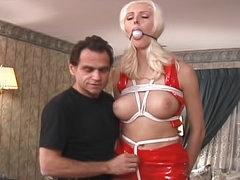 Bleach blonde in latex tied up