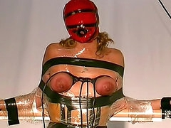 Tight rubber corset on his BDSM girl