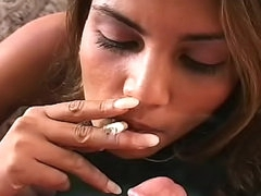 Exotic girl gives smoking blowjob
