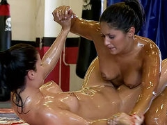Oiled up lesbian bodies play
