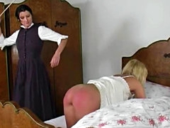 Naughty blonde gets her ass caned by..