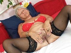 Sexy granny in stockings masturbating..