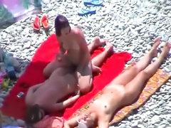 Girl on girl play at beach
