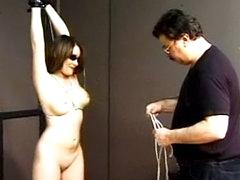 Blindfold babe with bondage on her tits