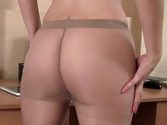 Office tease with skinny pantyhose girl
