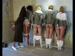 Nun spanks four schoolgirls