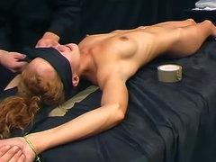Skinny redhead in sexy rope bondage