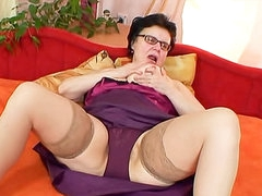 Fat mature nerd in stockings masturbates