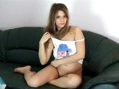 Pregnant girl models her bald vagina