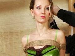 Skinny girl in pretty lingerie bound