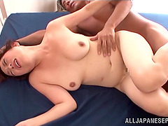 Chubby Japanese milf gets her cunt..