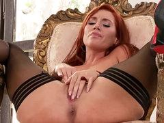 Redhead in black stockings masturbates..