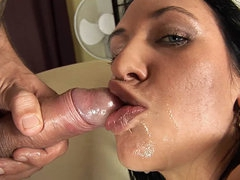 Brunette with cute dark eyes sucking giant cock
