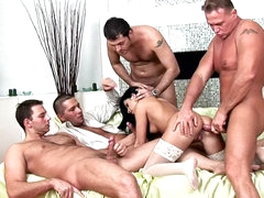 Sexy brunette in white stockings loves gang bang